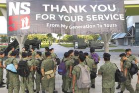NSmen assemble outside Temasek Polytechnic before one of the Singapore Armed Forces Day Combined Rededication Ceremonies.