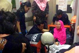 The scene at Block 542 Jurong West Avenue 1 on Saturday night, when a lift dropped four floors, injuring a woman in her 30s
