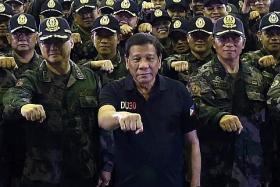 Duterte threatens to jail critics of martial law