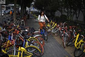 China to impose bike-sharing rules as complaints soar
