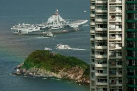 China's aircraft carrier draws HK crowd