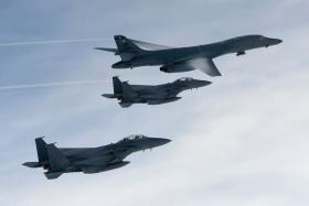 US bombers carried out a rare live fire drill in South Korea on July 8, flying close to the DMZ in a show of force after Pyongyang's latest missile test