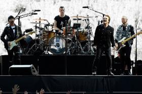 U2 performing at Twickenham Stadium in London.