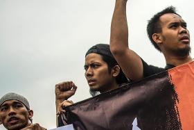 Jokowi signs decree to ban radical groups