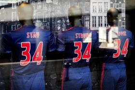 Three mannequins with shirts reading 'Stay Strong Appie' in the window of Ajax Amsterdam's fan shop, in Amsterdam as a message of support for Abdelhak Nouri, the Ajax youngster who collapsed on the pitch during a friendly match against Werder Bremen in Austria.