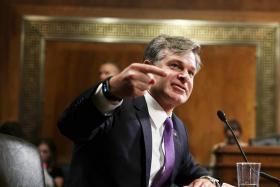 Trump's FBI pick says Russia probe is no 'witch hunt'
