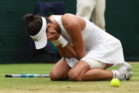 Spain's Garbine Muguruza celebrates after winning against US player Venus Williams during their women's singles final match at the Wimbledon Championships at The All England Lawn Tennis
