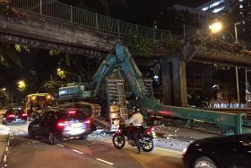 Excavator hits overhead bridge