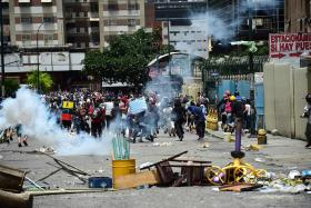 Venezuela shuts down as millions take to the streets