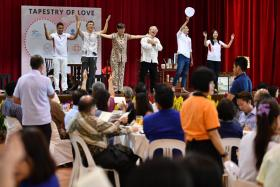 Programme coordinators putting on a performance at a lunch to thank volunteers from the Ang Mo Kio GRC.