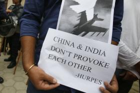 China warns India not to test its military