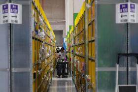 Employees at Amazon's Prime Now fulfilment centre in Jurong.