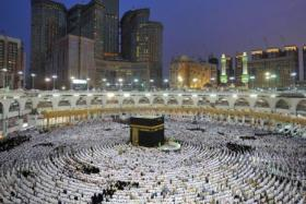 Muslim worshippers praying at the Kaaba, Islam's holiest shrine, at the Grand Mosque in Saudi Arabia's holy city of Mecca, during the last Friday of the holy month of Ramadan.