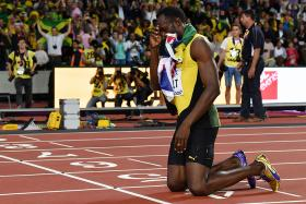 Jamaica's Usain Bolt poses after taking third in the final of the men's 100m athletics event at the 2017 IAAF World Championships at the London Stadium in London on August 5,