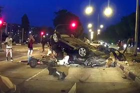 Tragedy in Woodlands as biker dies after car flips and hits him
