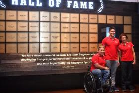 From left: Theresa Goh, Joseph Schooling and Laurentia Tan, in front of the Sport Hall of Fame at the Singapore Sports Hub on Tuesday. The trio are the latest inductees in the Hall of Fame.