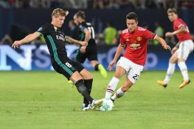 Manchester United midfielder Ander Herrera (right) vies for the ball with Real Madrid's Toni Kroos during the Uefa Super Cup.
