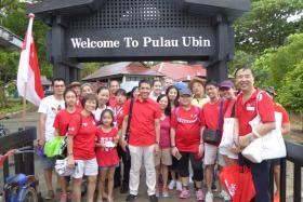 Families at the walk at Pulau Ubin.