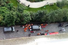 Officials and rescuers gather near vehicles after a car slammed into a group of anti-terrorism soldiers, injuring six.