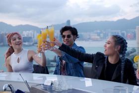 Narelle Kheng, Benjamin Kheng and Sandra Riley Tang at rooftop bar Skye