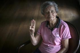 Ms Christabelle Alvis, who has served Girl Guides Singapore for 65 years, giving a Girl Guides salute.
