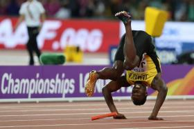 Jamaica's Usain Bolt falls after injuring himself in the final of the men's 4x100m relay at the IAAF World Championships.