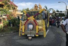 The hearse for businessman Rajadanran Suppiah stands waiting at his wake at Lentor Terrace on 14 August 2017.