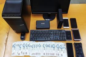 Criminal Investigation Department officers seized about $4,000 worth of cash, a computer and a mobile phones as case exhibits in the raid on Wednesday (Aug 16)