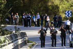 Police officers at the site where they have shot a man wearing what looked like an explosive belt, and believed to be the alleged attack van driver Younes Abouyaaqoub, during a police operation in Subirats, near Barcelona, 21 August 2017