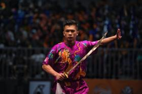 Singapore's Jowen Lim performing his routine during the SEA Games men's daoshu event on Aug 2. He won the changquan event on Aug 22.