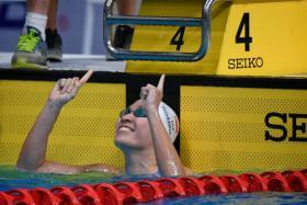 Swimmer Roanne Ho celebrates after winning the SEA Games women's 50m breaststroke final.