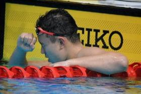 Francis Fong celebrates after winning silver in the SEA Games 200m backstroke final.
