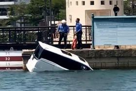 Car falls into sea after chase