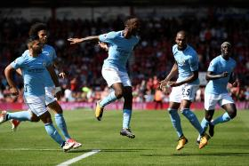 Manchester City's Raheem Sterling celebrates scoring their second goal