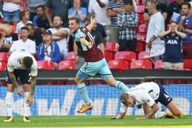 Burnley's New Zealand striker Chris Wood celebrates after scoring the late equalizer against Spurs