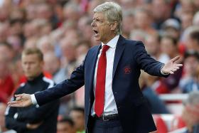 Wenger slams players for 'absolutely disastrous' display