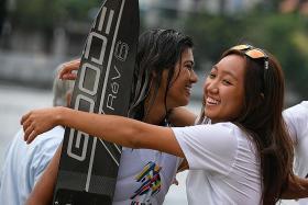 Sabelle Kee (right) congratulating Sasha Christian on her slalom win.