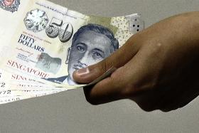 For businesses in Singapore, cash is still king