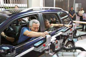 PM Lee testing out the prototype of the Automated Passenger In-Car Clearance System (APICS) at Woodlands Checkpoint.