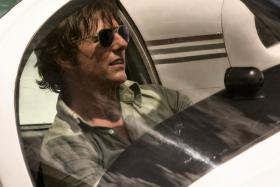 American Made is the second film for Tom Cruise (above) with director Doug Liman, after Edge of Tomorrow in 2014. PHOTO: UIP
