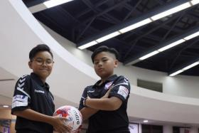 Danial Feroz of Swiss Cottage Secondary (left) and Tan Yu Hen of Hong Kah Secondary were picked to attend Yuhua Albirex Football Academy training and cultural tour in Niigata, Japan, where the parent club of S-League champions Albirex Niigata is based.