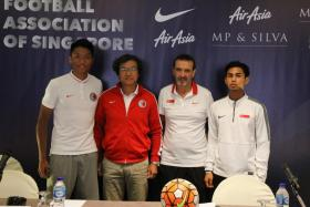 Hong Kong coach Kim Pan Gon (second from left), seen here with Hong Kong defender Lau Hok Ming, Singapore youth coach Richard Tardy and Singapore footballer Adam Swandi at a pre-match press conference on 19 July 2016, is a fan of Singapore football's youth set-up.