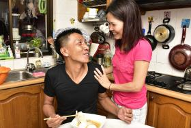 Mr Shoo Chiau Huat enjoying a meal in prepared by his wife, Jasmine, in their Sengkang flat on 29 August 2017