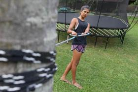 Despite being unable to return to the water during a prolonged recovery period after breaking her right fibula last year, Sasha Christian used an ingenious training method instead, using a palm tree as a tether while working on her waterskiing posture