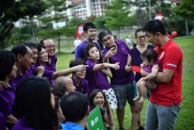 Members of the Teow family with Social and Family Development Minister Tan Chuan-Jin, holding seven-month-old Chloe Sek, at the picnic event yesterday. Chloe is a fourth-generation member of the family.