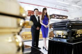 Undertaker Roland Tay with his daughter Jenny Tay at Direct Funeral Services' (DFS) showroom in Geylang Bahru.