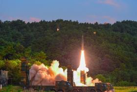 South Korea's missile system firing Hyunmu-2 missile into the East Sea from an undisclosed location on South Korea's east coast during a live-fire exercise simulating an attack on North Korea's nuclear site