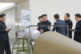 North Korean state media published photographs of leader Kim Jong Un inspecting a peanut-shaped device that it said was a hydrogen bomb designed to be loaded on a new ICBM.