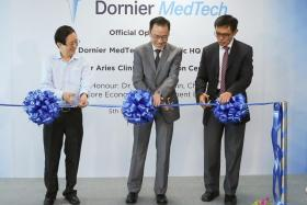 ccuron MedTech chairman Philip Yeo, Economic Development Board chairman Beh Swan Gin and Mr Abel Ang, chief executive of Dornier MedTech and group CEO of Accuron MedTech, officially opening Dornier MedTech's Asia-Pacific Headquarters and Global Clinical Innovation Centre in Jurong East on 5 September 2017.