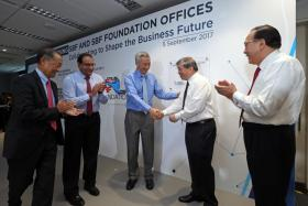 The merger was announced yesterday at the opening of SBF's new office, which was attended by (from left) former SBF chairman Stephen Lee, Mr S. Iswaran, Prime Minister Lee Hsien Loong and Mr Teo Siong Seng.